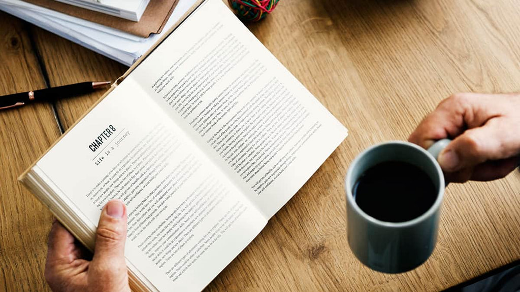Person reading and drinking coffee - Keep learning